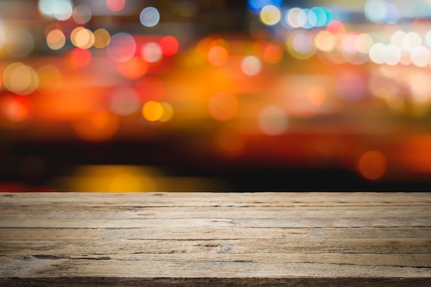 Empty wooden table platform and bokeh at night for product display montage. Premium Photo