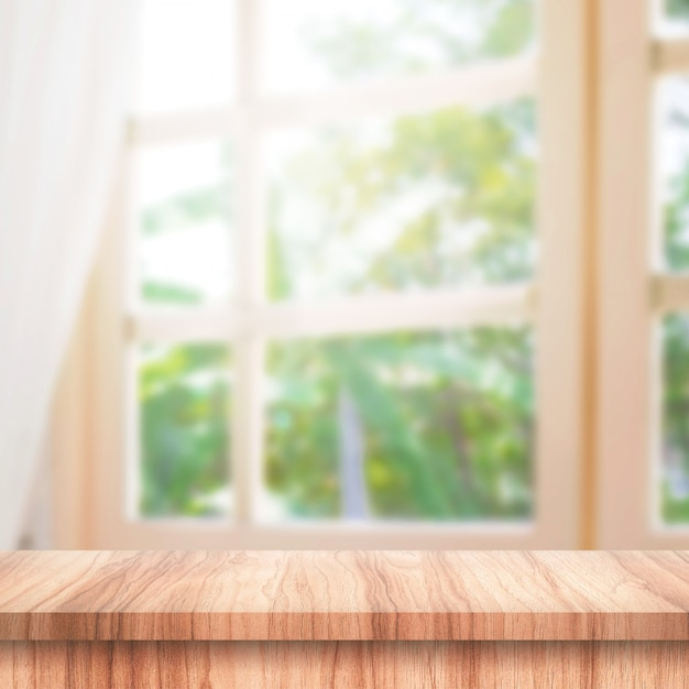 Empty of wooden table top on curtain and window Premium Photo