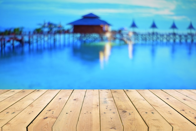 Empty wooden table top with blurred seascape Premium Photo