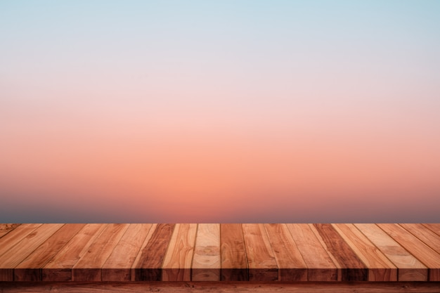 Empty wooden table with abstract gradient sunrise in the sky natural background. Premium Photo