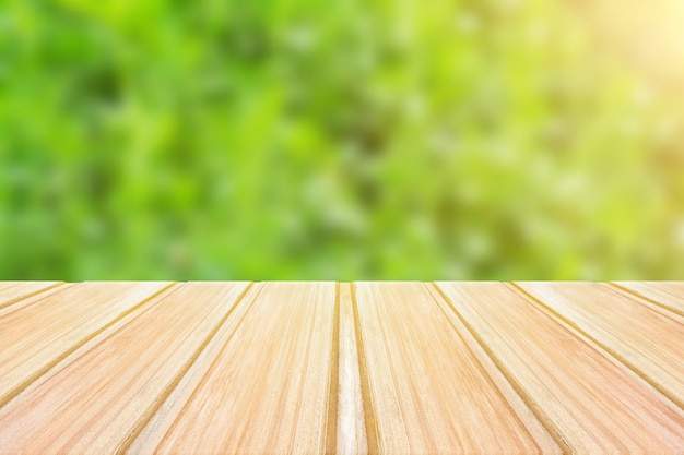 Empty wooden table with blurred green background. concept party, products, spring Premium Photo
