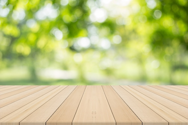 empty wooden table with natural background free space for product