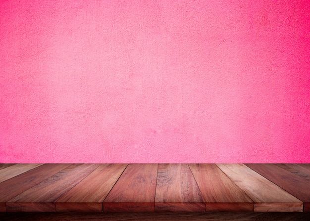 Empty wooden table with pink wall background Premium Photo