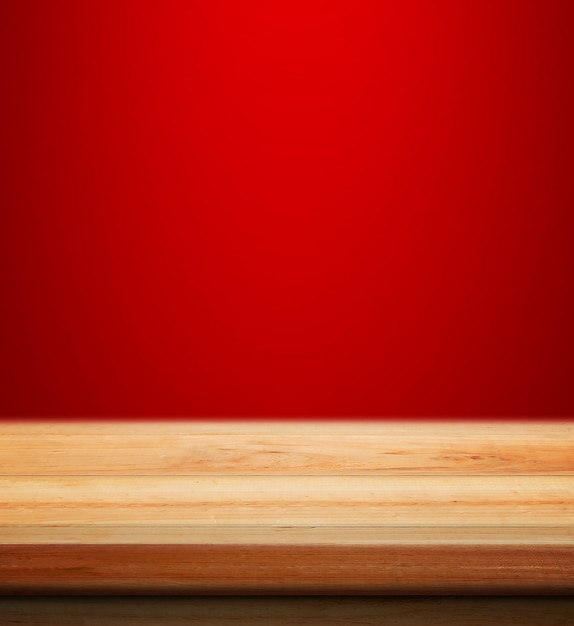 Empty wooden table with red christmas background for product placement with blur christmas wallpaper background Free Photo