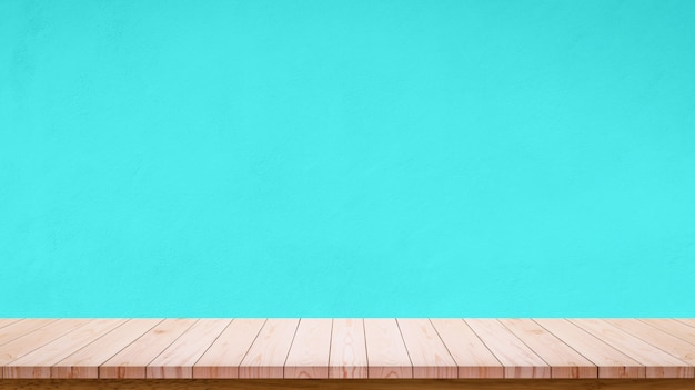 Empty wooden table with sky blue wall Premium Photo