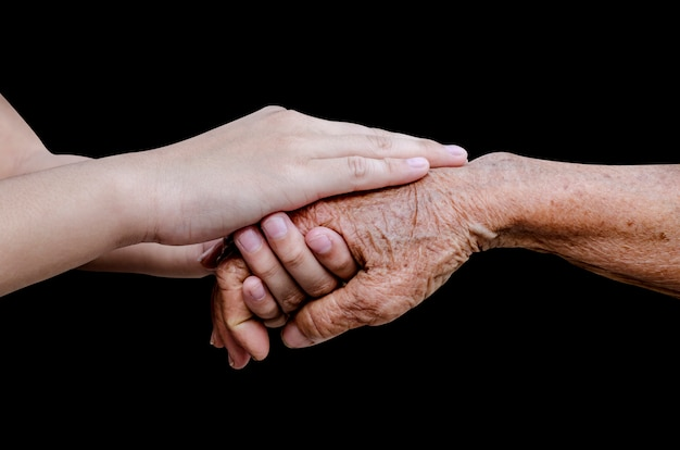 Encouragement old and young hands Premium Photo