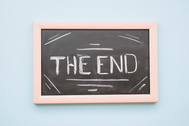 The end lettering in a blackboard Free Photo