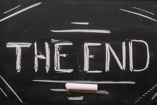 The end lettering in a blackboard Premium Photo