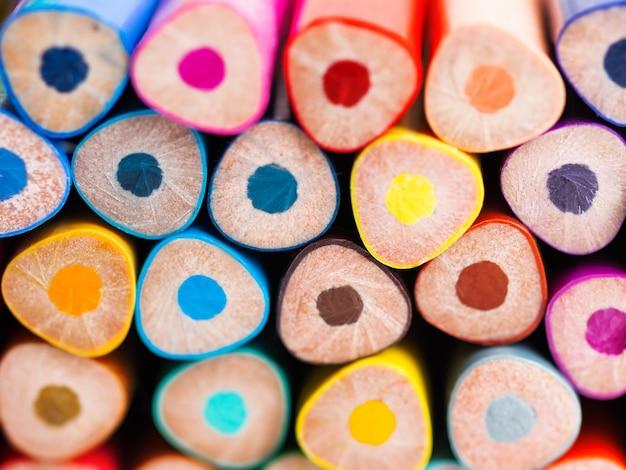 Ends of colorful watercolor pencils. school supplies background. Premium Photo