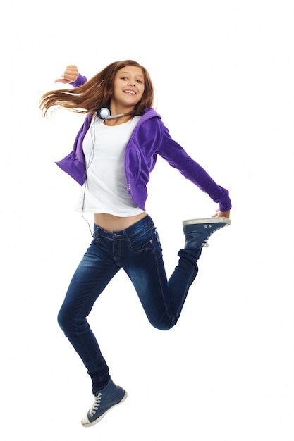 Energetic teenager jumping Free Photo