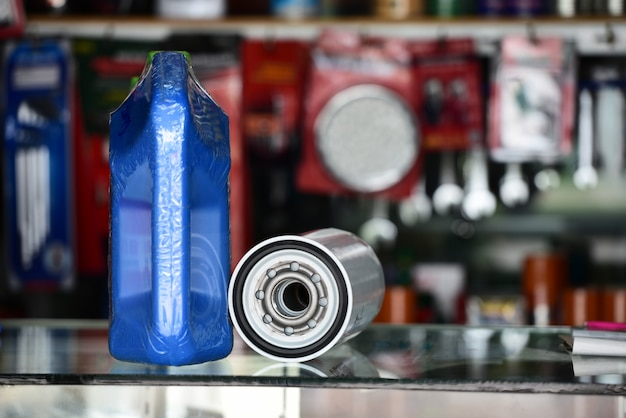 Engine oil and oil filter for cars in the shop, automotive parts. Premium Photo