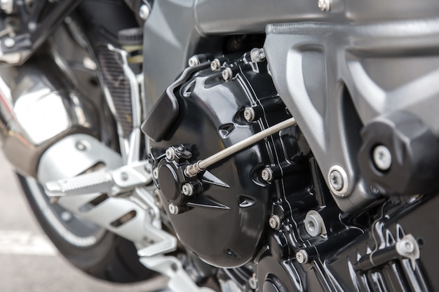 Engine parts of a racing motorcycle close-up. Premium Photo