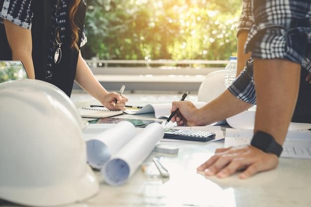 Engineer construction people group teamwork meeting project blueprint Premium Photo
