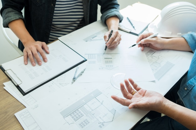 Engineer discussing meeting working on blueprint project architectural at construction site. Premium Photo