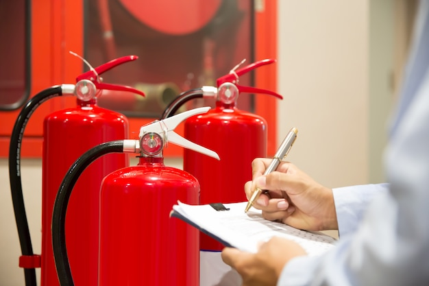 Engineer inspection fire extinguisher. Premium Photo