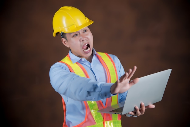 Engineer man, construction worker scared in shock Free Photo
