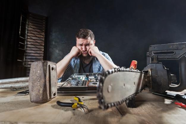 Engineer repairs laptop, repairman fix problem Premium Photo
