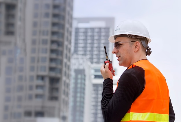 Engineer talking on the walkie-talkie for communication with team Premium Photo