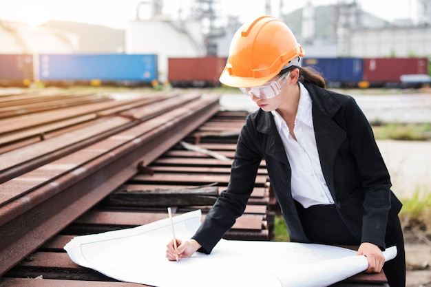 Engineer worker concept working at oil refinery. Premium Photo