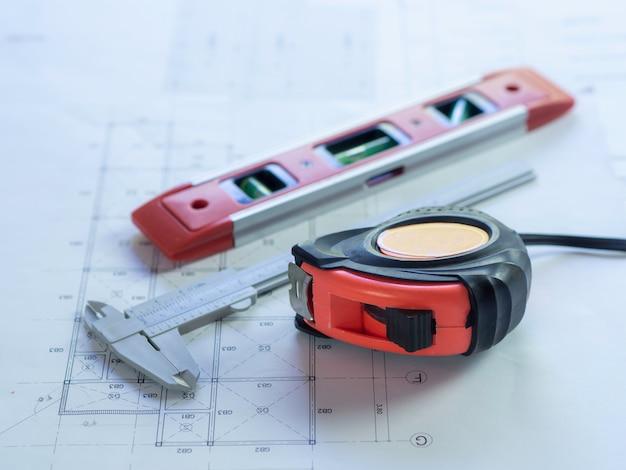 Engineering use equipment to make construction blueprint drawing Premium Photo