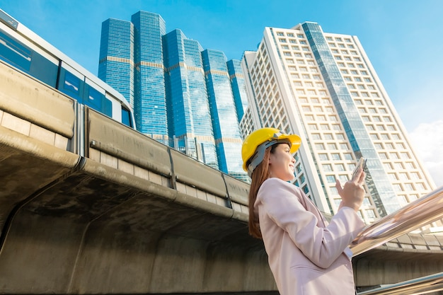 Engineering woman  is working in outdoor city background Premium Photo