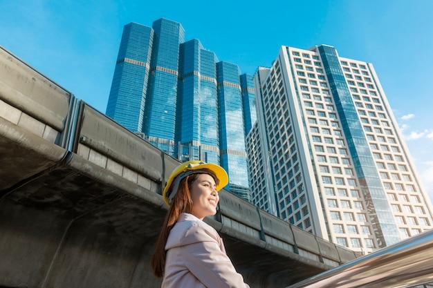 Engineering woman is working in outdoor city Premium Photo