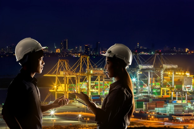 Engineers are working on a shipping port at night. Premium Photo