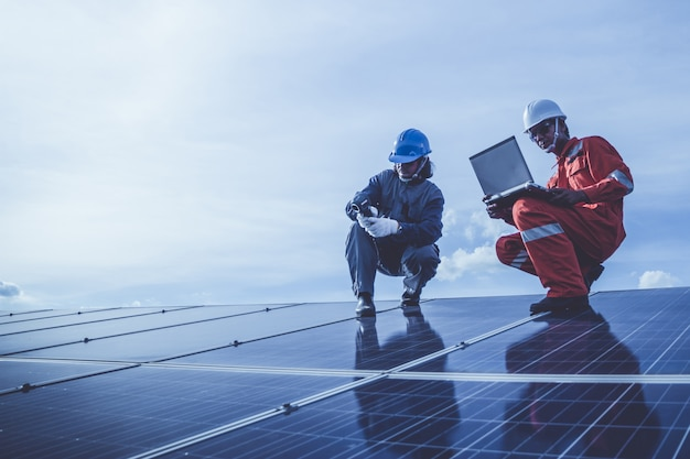 Engineers operating and check generating power of solar power plant on solar rooftop Premium Photo