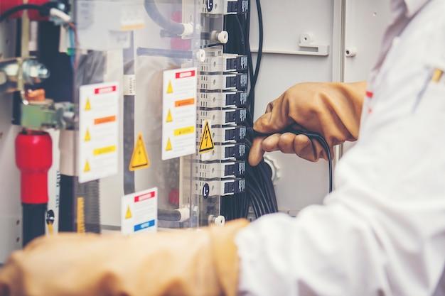Engineers working on monitoring and maintenance equipment: cheking inverter status Premium Photo
