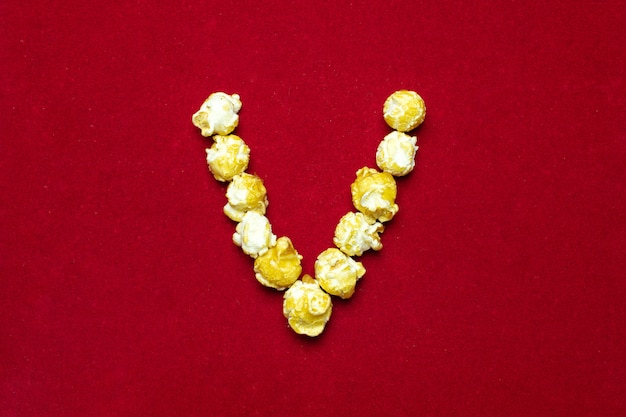 English alphabet from cinema popcorn. letter v. Premium Photo