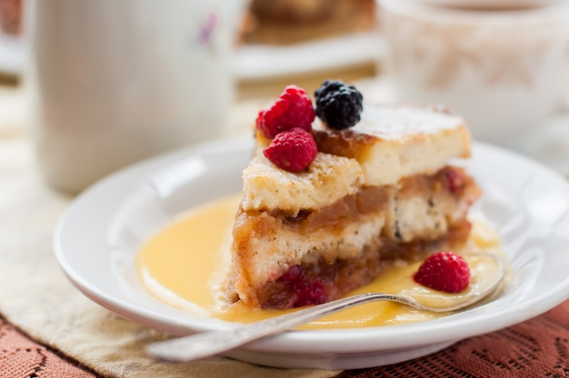 English bread and butter pudding with apples and cranberries Premium Photo