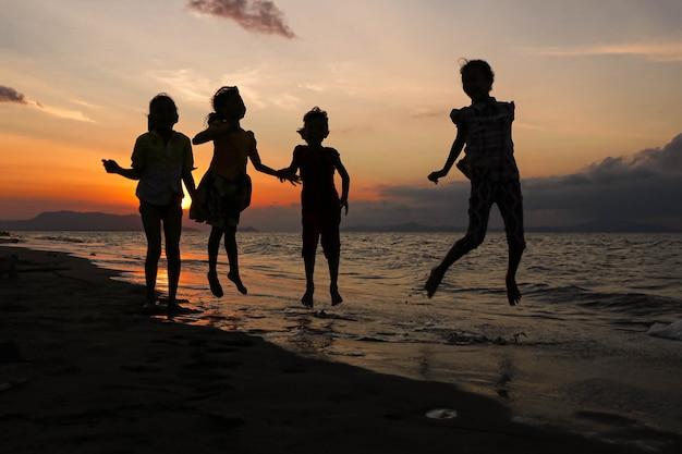Enjoy the sunset in indonesian beach Premium Photo