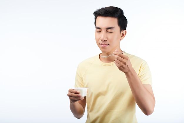 Enjoying delicious yogurt Free Photo