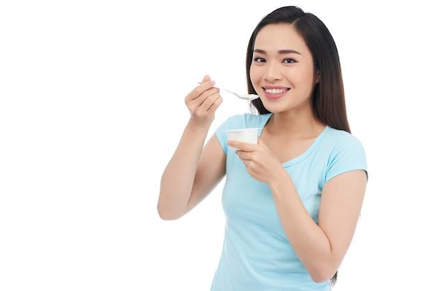 Enjoying greek yogurt Free Photo
