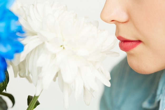 Enjoying smell of white chrysanthemum Free Photo