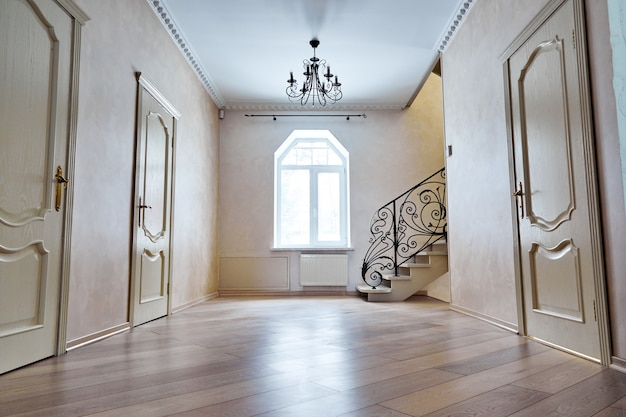 Entrance hallway with staircase. viewsteps with wrought iron railings Premium Photo