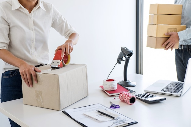 Entrepreneur sme receive order client and working with packaging sort box delivery online market Premium Photo