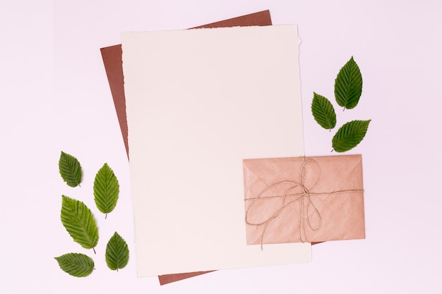Envelope card with leaves copy space Free Photo
