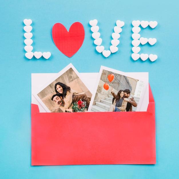 Envelope with photos near love writing Free Photo