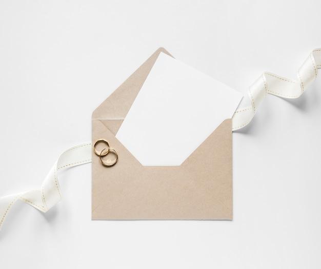 Envelope with wedding card Free Photo