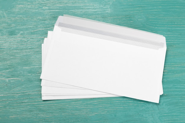 Envelopes on wooden table Premium Photo