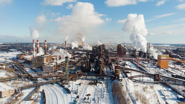 Environmental disaster. poor environment in the city. smoke and smog. pollution of the atmosphere by plants. exhaust gases. harmful emissions into the environment Premium Photo