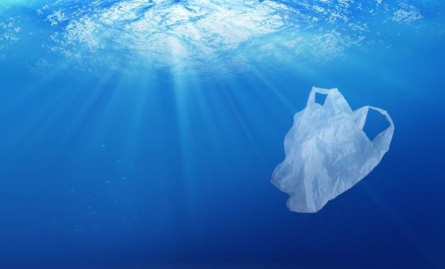 Environmental protection concept. plastic bag pollution in ocean Premium Photo