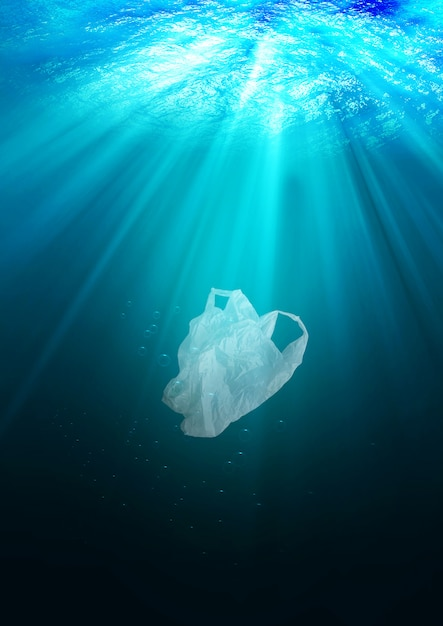 Environmental protection concept. plastic bag pollution in ocean Premium Photo