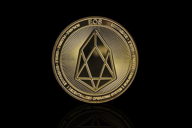 Eos cryptocurrency coin on black Premium Photo
