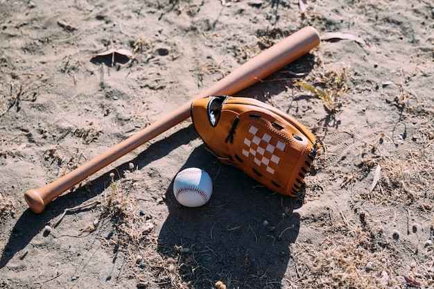 Equipment for baseball game on ground Free Photo