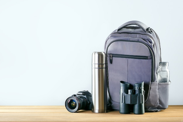 Equipment for hiking on wooden table with place for text. Premium Photo
