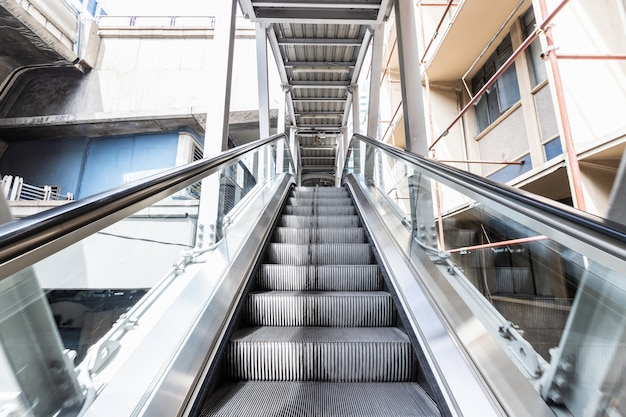 Escalator bts skytrain station is a public place,mechanical escalators for people up and down Premium Photo