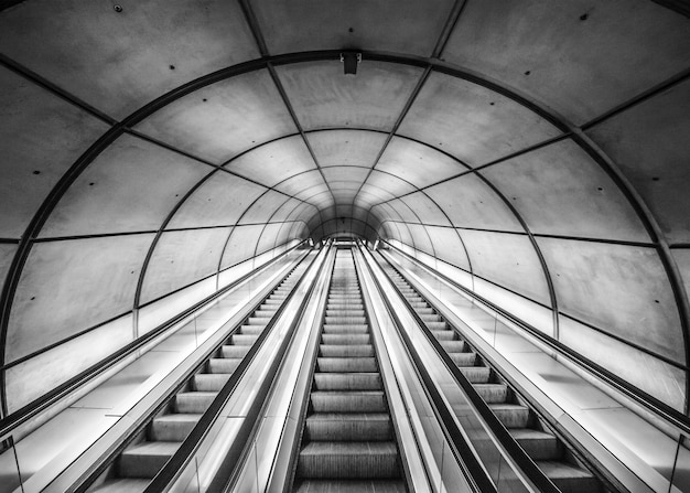 Escalators of a meter that ascend until the exit to the outside.the exit Premium Photo