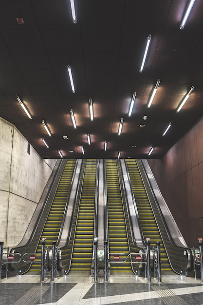 Escalators of a subway station in an urban city Free Photo